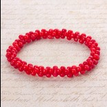 Zdjęcie - Bransoletka z kosteczek korala na gumce czerwona 20cm