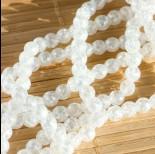 Zdjęcie - Kryształ górski kulki fasetowane spękane białe z efektem AB 6mm